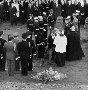 Jacqueline Kennedy holding folded flag from casket of President John F. Kennedy